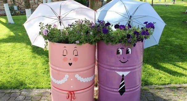 Garden Art Ideas diy junk garden art Repurpose Old Oil Drums Garden Umbrella Flower Planter