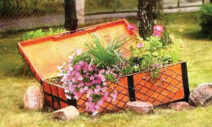 upcycling garden ideas wooden chest flower planter stone border - Garden Ideas Pictures