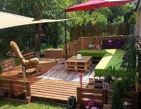 outdoor pallet furniture ideas upcycled wooden sofa diy vertical pallet garden green cushion - Garden Ideas With Pallets