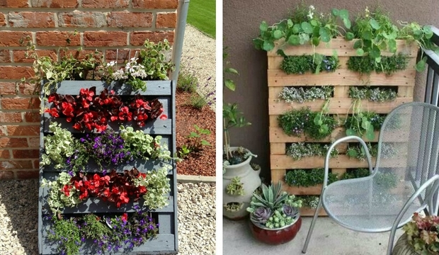 vertical pallet garden balcony brick wall metal armchair flower pots