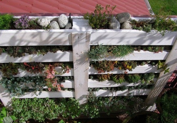 vertical white pallet flower garden stone decorated