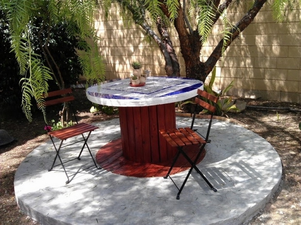 wooden cable spool garden table mosaic decoration wooden chairs backyard  patio