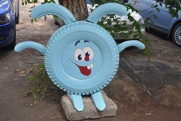 how to reuse old tire transform waste tire into blue funny rabbit garden smile cute bunny diy tires decoration