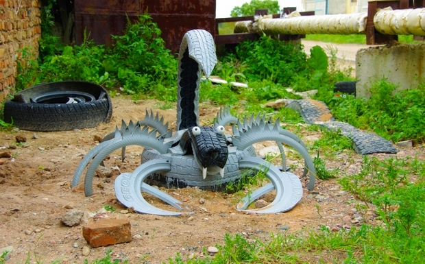 upcycling tire craft grey scorpion garden idea unwanted waste tires - Garden Ideas Using Tyres