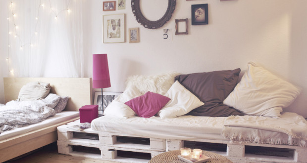 pallet-bed-frame-diy-cheap-design-pallets-sofa-furniture-pink-bedside-lamp-shabby-chic-paintings