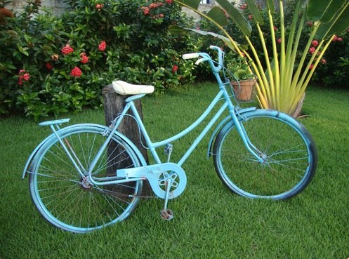 blue painted reused bike in the garden as amazing decoration