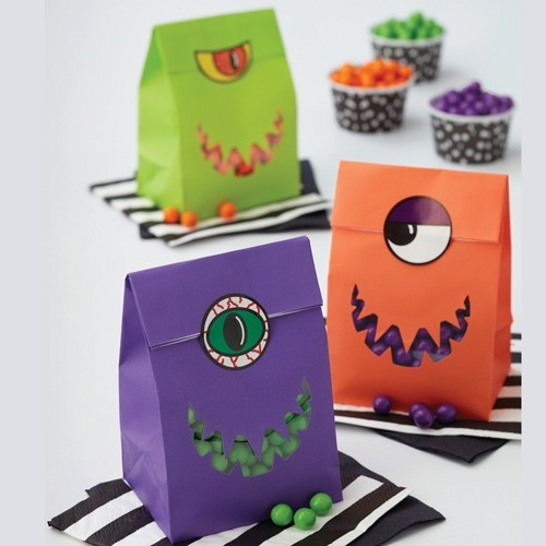 halloween goody bag idea blue red green paper candy bags spooky eyes decoration