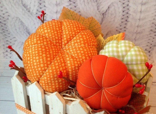 stuffed fabric pumpkin orange hues strings decorations