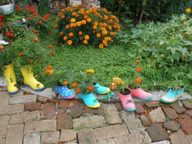 creative upcycling ideas colorful flower boots garden border