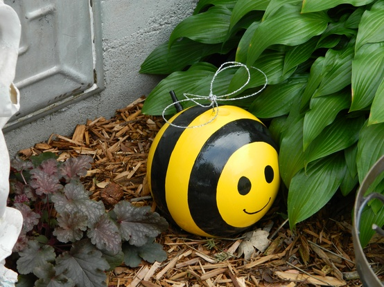 upcycling garden ideas art creative reuse bowling ball cute honey bee