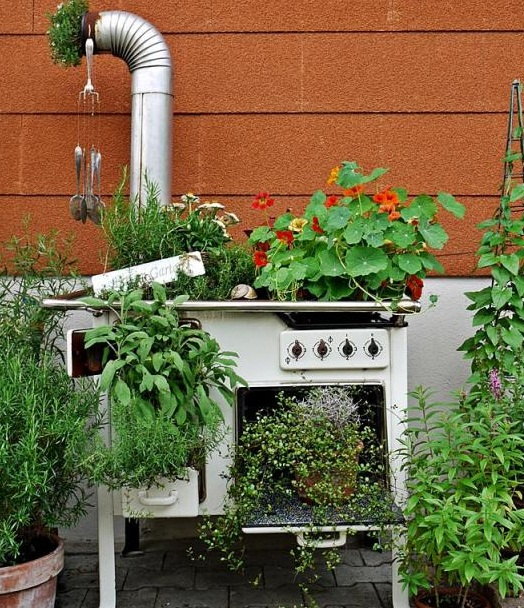 junk garden ideas upcycled old white oven flower planter