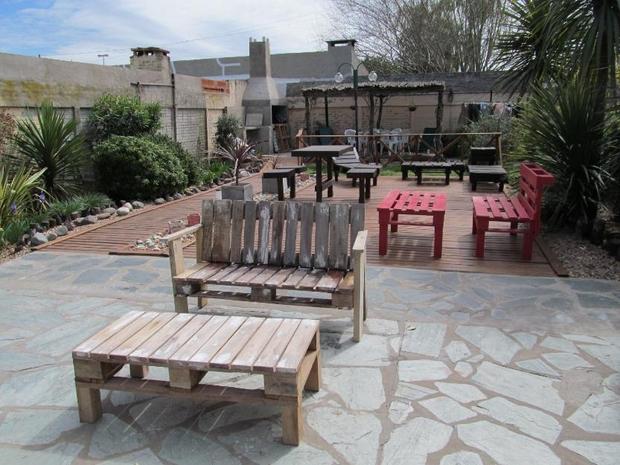 outdoor pallet furniture ideas backyard patio table benches stone floor garden paving design - Patio On A Pallet