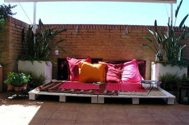 outdoor pallet furniture ideas creative backyard lounge red pillows brick wall