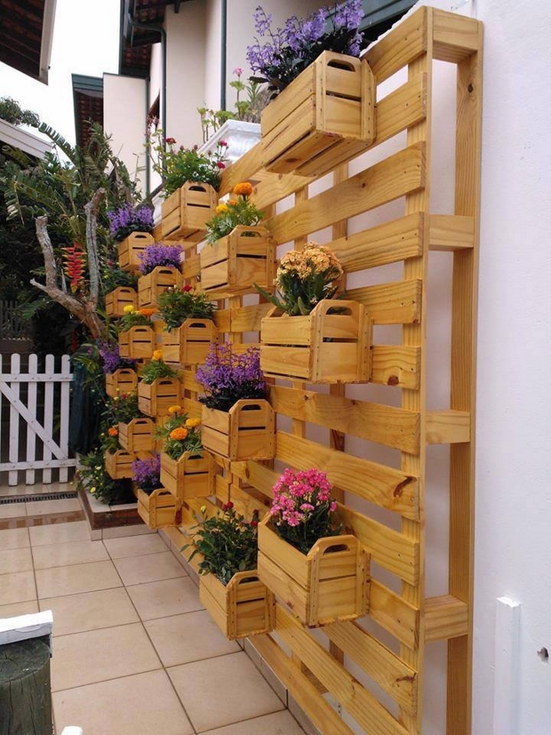 vertical pallet garden varnished wood white wall backyard patio decoration