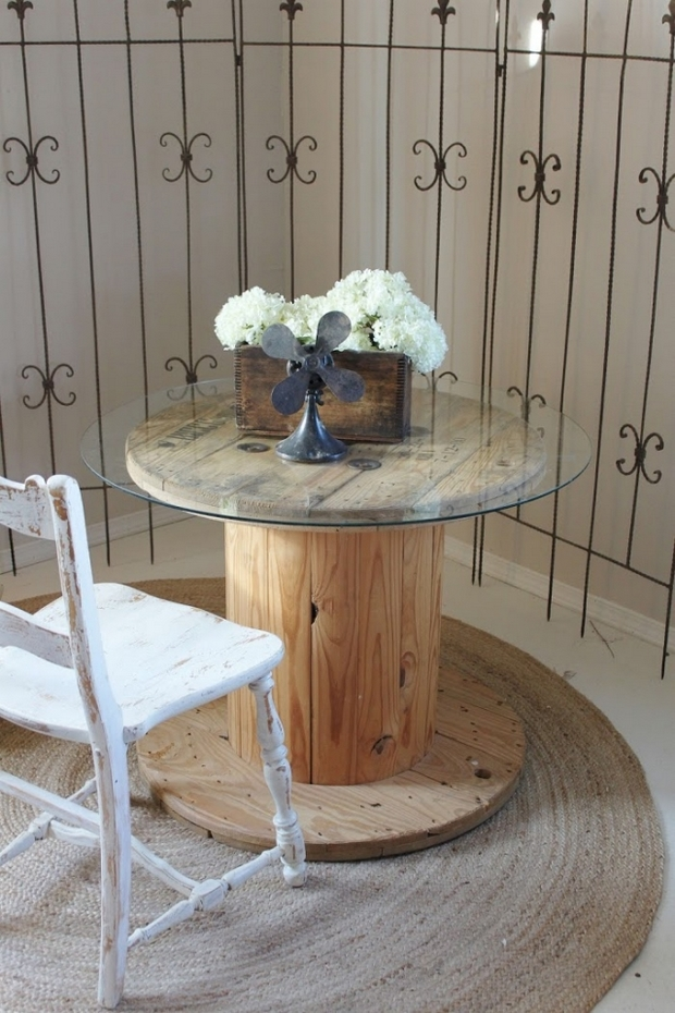 wooden cable spool table glass top white chair burlap carpet flower centerpiece