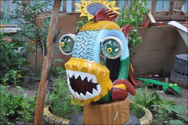 Tire recycling ideas used tire predator fish idea sharp teeth garden outdoor repurpose tires project