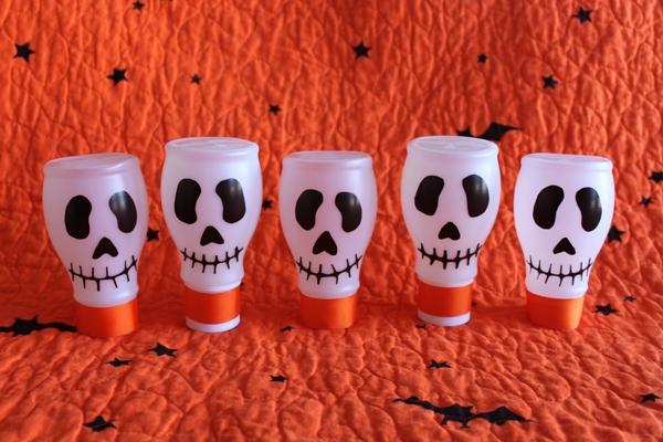 halloween skulls decoration party ideas empty milk bottles