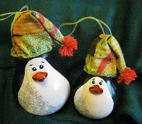 cute penguins with hats made of old bulbs homemade christmas ornaments