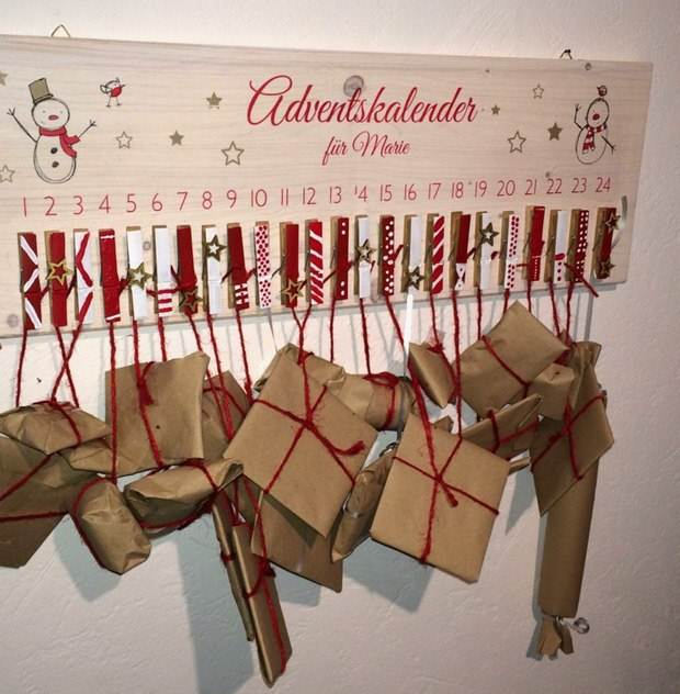 upcycling christmas calendar from recycled clothespins hanging wrapped gifts