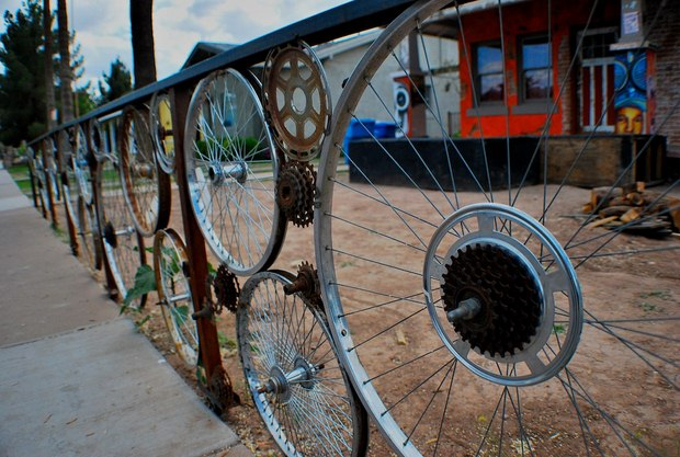 old bicycle wheels used as garden fence creative idea