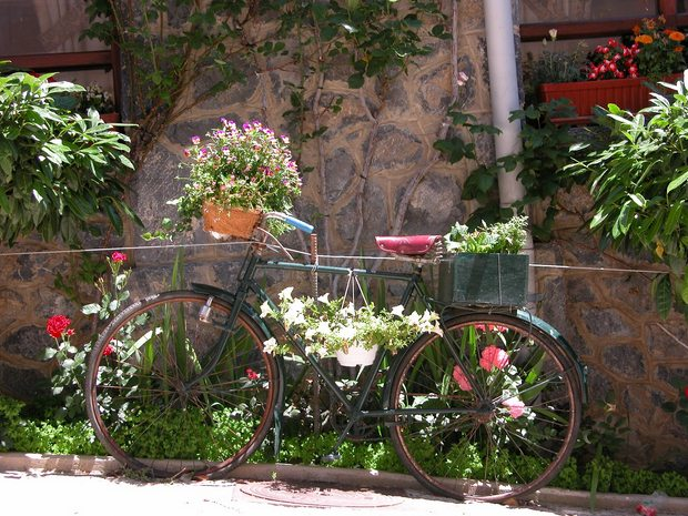 upcycled old green bike into garden flower planter decoration