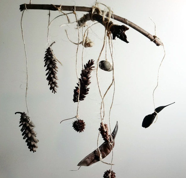 wind chime crafts decoration made of pine cones and wooden forest sticks