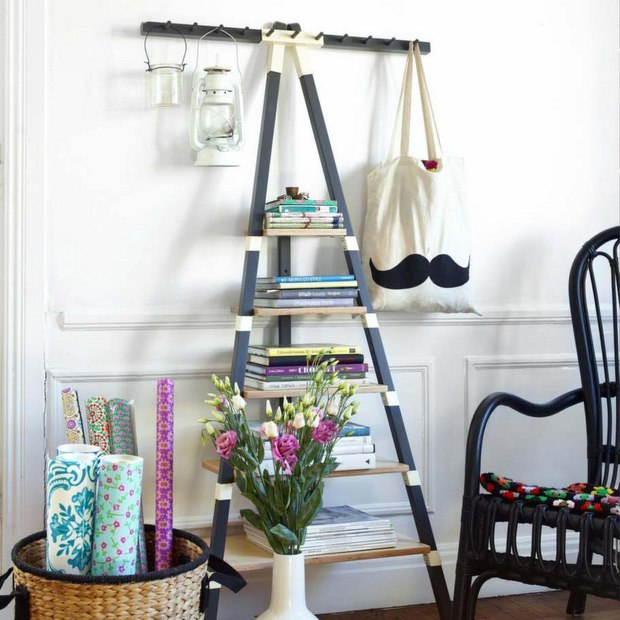 diy upcycled ladder bookshelves with hanging lanterns wall decorating idea