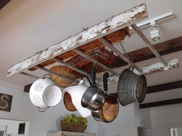 repurposed vintage wooden rack ladder hanging from the ceiling in the kitchen
