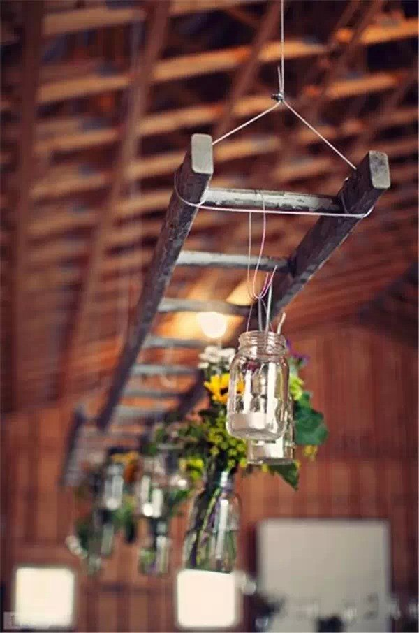 repurposed wooden rustic wedding ladder hanging from ceiling with flower glass pots