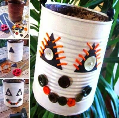 diy halloween monster made of old tin can sewing buttons white painted creepy decorated