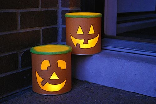 old tin cans lanterns for halloween projects outdoor decoration