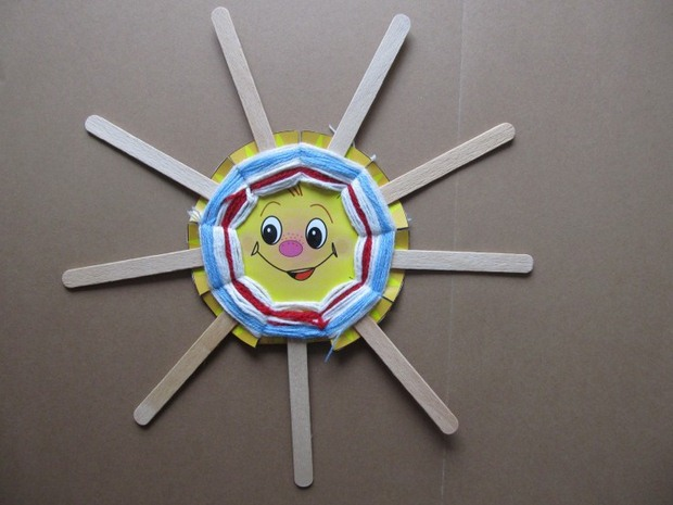 unused popsicle sticks crafts happy yellow sun decor ideas