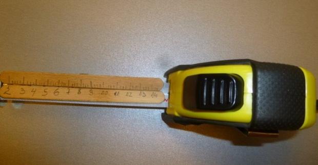 reused popsicle stick as tape measure diy idea