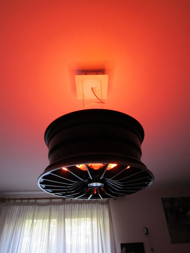 reuse car rims upcycled black chandelier red lights art idea