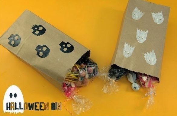 halloween goody bag idea brown reused paper ghost prints black skulls