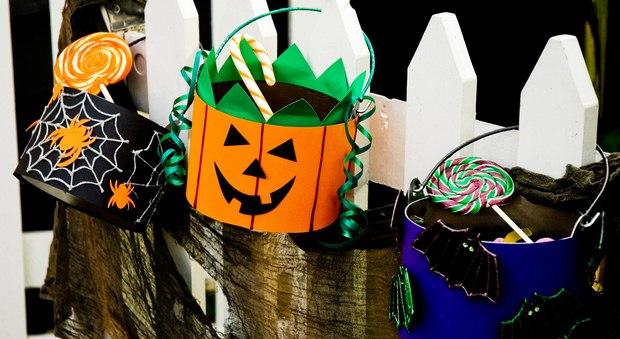 halloween goody bag ideas three metal boxes spider web pumpkin black bats hanging fence decor